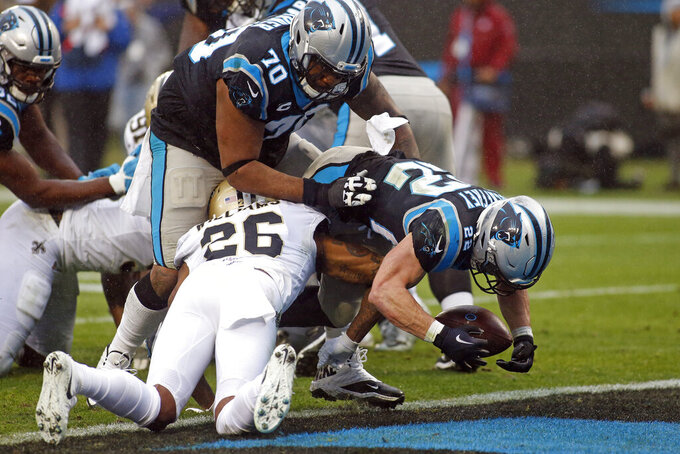 Carolina Panthers running back Christian McCaffrey (22) scores a touchdown against the New Orleans Saints during the second half of an NFL football game in Charlotte, N.C., Sunday, Dec. 29, 2019. (AP Photo/Brian Blanco)