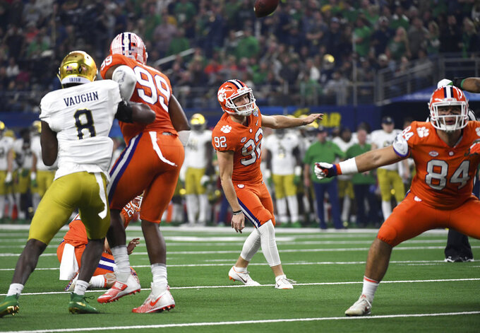 Notre Dame's Donte Vaughn (8) and Clemson defensive end Clelin Ferrell (99) watch as the ball sails back over place kicker Greg Huegel (92) after it was blocked on a field goal attempt in the first half of the NCAA Cotton Bowl semi-final playoff football game, Saturday, Dec. 29, 2018, in Arlington, Texas. (AP Photo/Jeffrey McWhorter)