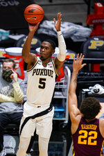 Purdue guard Brandon Newman (5) shoots as Minnesota guard Gabe Kalscheur (22) defends during the second half of an NCAA college basketball game in West Lafayette, Ind., Saturday, Jan. 30, 2021. (AP Photo/Michael Conroy)