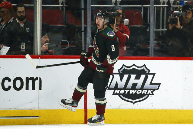 Arizona Coyotes right wing Clayton Keller shouts as he celebrates his goal against the Buffalo Sabres during the second period of an NHL hockey game Saturday, Feb. 29, 2020, in Glendale, Ariz. (AP Photo/Ross D. Franklin)
