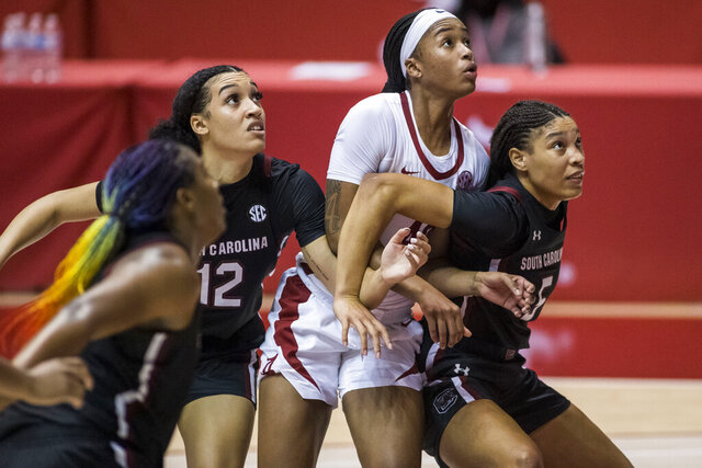 South Carolina guard Brea Beal (12) and forward Victaria Saxton (5) battle Alabama forward Jasmine Walker (40) under the basket during the second half of an NCAA college basketball game, Monday, Jan. 4, 2021, in Tuscaloosa, Ala. (AP Photo/Vasha Hunt)