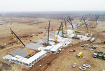 In this aerial photo released by China's Xinhua News Agency, workers build a large centralized quarantine facility in Shijiazhuang in northern China's Hebei Province, Thursday, Jan. 14, 2021. A city in northern China is building a 3,000-unit quarantine facility to deal with an anticipated overflow of patients as COVID-19 cases rise ahead of the Lunar New Year travel rush. (Yang Shiyao/Xinhua via AP)