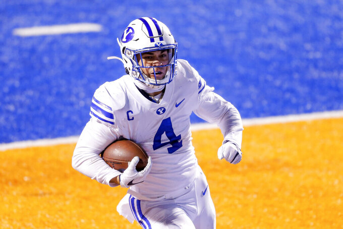 BYU running back Lopini Katoa celebrates a 20-yard touchdown run against Boise State during the second half in an NCAA college football game Friday, Nov. 6, 2020, in Boise, Idaho. (AP Photo/Steve Conner)