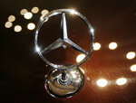 FILE - In this Feb. 5, 2015 file photo the logo of a Mercedes car is photographed during an annual press conference of Daimler AG in Stuttgart, Germany. Daimler hat its annual press conference on Wednesday. (AP Photo/Michael Probst)