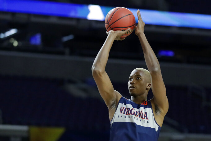 Virginia's Mamadi Diakite (25) shoots during a practice session for the semifinals of the Final Four NCAA college basketball tournament, Friday, April 5, 2019, in Minneapolis. (AP Photo/Jeff Roberson)