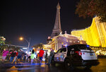 Metropolitan police are present outside Paris Las Vegas following a major power outage in the hotel-casino on Thursday, Oct. 22, 2020, in Las Vegas. Caesars Entertainment says the power has been restored at Paris Las Vegas after an outage forced hundreds of guests at the Strip hotel to evacuate. (Ellen Schmidt/Las Vegas Review-Journal via AP)