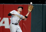 Pittsburgh Pirates right fielder Bryan Reynolds catches a fly ball by St. Louis Cardinals' Kolten Wong for an out during the second inning of a baseball game Monday, July 15, 2019, in St. Louis. (AP Photo/Jeff Roberson)