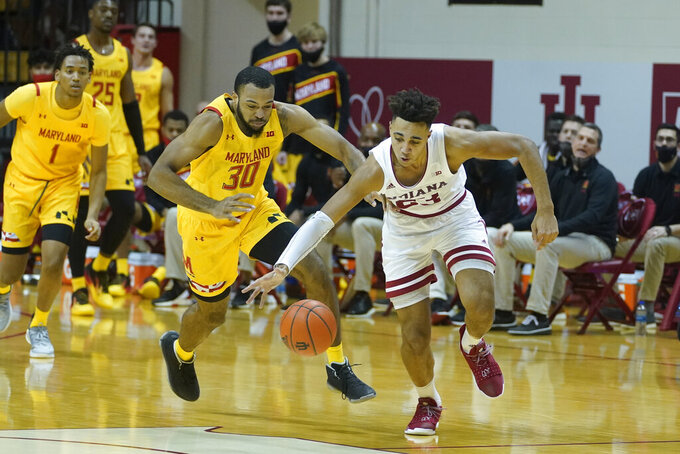 Indiana forward Trayce Jackson-Davis (23) steals the basketball from Maryland forward Galin Smith (30) during the second half of an NCAA college basketball game, Monday, Jan. 4, 2021, in Bloomington, Ind. (AP Photo/Darron Cummings)