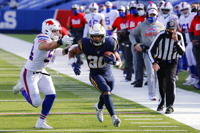 Los Angeles Chargers running back Austin Ekeler (30) runs against Buffalo Bills outside linebacker A.J. Klein (54) during the first half of an NFL football game, Sunday, Nov. 29, 2020, in Orchard Park, N.Y. (AP Photo/Jeffrey T. Barnes)