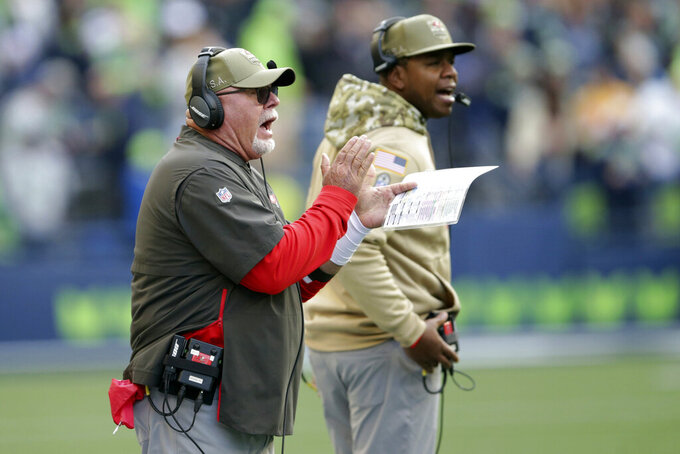 Tampa Bay Buccaneers head coach Bruce Arians, left, calls to his team during the second half of an NFL football game against the Seattle Seahawks, Sunday, Nov. 3, 2019, in Seattle. (AP Photo/Scott Eklund)