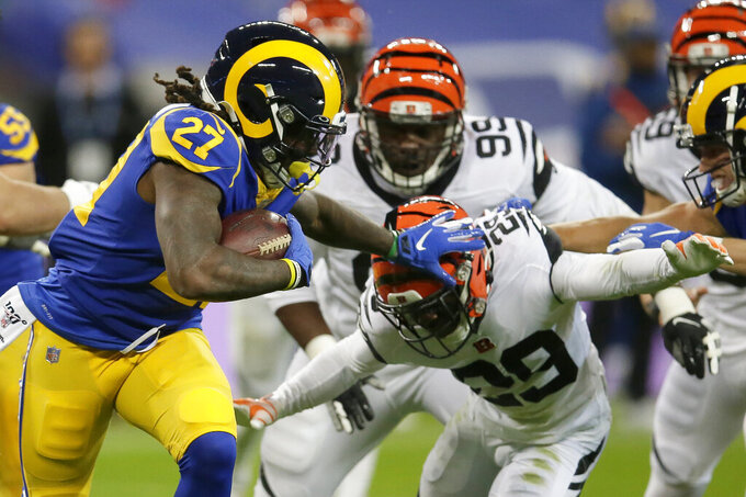 Los Angeles Rams running back Darrell Henderson (27) runs against Cincinnati Bengals cornerback Tony McRae (29) during the first half of an NFL football game, Sunday, Oct. 27, 2019, at Wembley Stadium in London. (AP Photo/Tim Ireland)