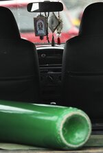 An empty oxygen tank sits in a car featuring iconic images of