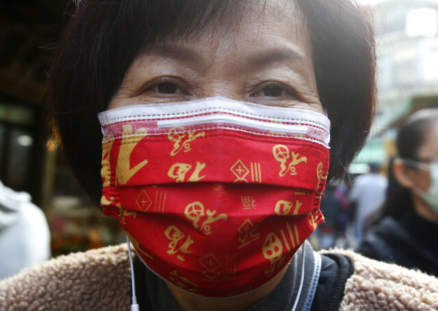 A woman wears a Chinese auspicious character