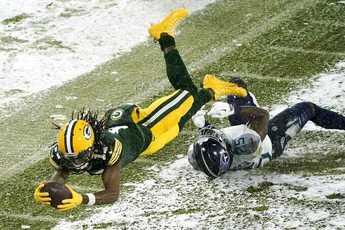 Green Bay Packers' Davante Adams gets past Tennessee Titans' Adoree' Jackson for a touchdown catch during the first half of an NFL football game Sunday, Dec. 27, 2020, in Green Bay, Wis. (AP Photo/Morry Gash)
