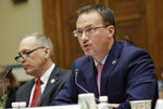Rep. Michael Cloud, R-Texas, right, speaking before the House Oversight Committee hearing on family separation and detention centers, Friday, July 12, 2019 on Capitol Hill in Washington. Seated next to Cloud is Rep. Andy Biggs, R-Ariz., left. (AP Photo/Pablo Martinez Monsivais)