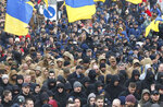 Holding Ukrainian state flags, members of far-right groups hold a mass demonstration against government corruption on the Independence Square in Kiev, Ukraine, Saturday, March 23, 2019.(AP Photo/Efrem Lukatsky)