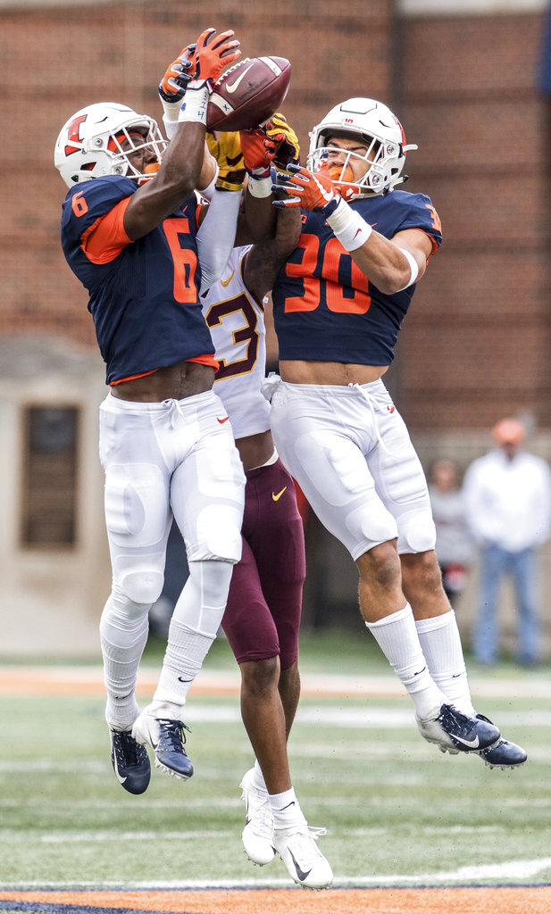 Illinois' Tony Adams (6) and Sydney Brown (30) go up for an interception in the first half of an NCAA  college football game, Saturday, Nov. 3, 2018, in Champaign, Ill. (AP Photo/Holly Hart)
