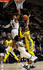 Marquette's Markus Howard, right, cannot get a shot past Villanova's Phil Booth, left, and Saddiq Bey during the first half of an NCAA college basketball game, Wednesday, Feb. 27, 2019, in Villanova, Pa. (AP Photo/Matt Slocum)