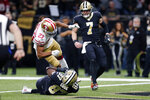 San Francisco 49ers cornerback Ahkello Witherspoon (23) hits New Orleans Saints tight end Jared Cook (87) as he pulls in touchdown reception in the first half an NFL football game in New Orleans, Sunday, Dec. 8, 2019. (AP Photo/Brett Duke)