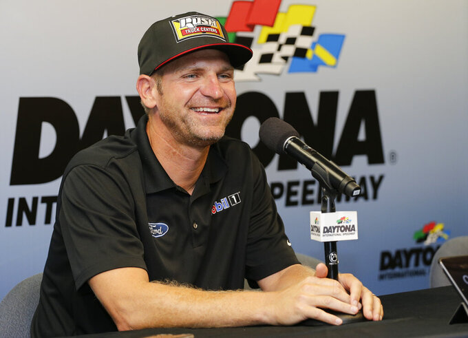Clint Bowyer answers questions at a news conference before a NASCAR Cup Series auto race at Daytona International Speedway, Saturday, July 6, 2019, in Daytona Beach, Fla. (AP Photo/Terry Renna)