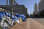 FILE - This May 21, 2020, file photo shows a homeless encampment atop the Main Street overpass of the 101 freeway during the coronavirus outbreak in downtown Los Angeles. The number of homeless people counted across Los Angeles County jumped 12.7% over the past year to more than 66,400, according to data released Friday, June 12, by the Los Angeles Homeless Services Authority. Authorities fear that figure will spike again once the full impact of the coronavirus pandemic is felt. (AP Photo/Mark J. Terrill, File)