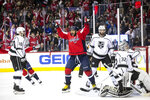 Washington Capitals left wing Alex Ovechkin (8), of Russia, celebrates after assisting a goal scored by defenseman Christian Djoos (29), of Sweden, during the second period of an NHL hockey game against the Los Angeles Kings, Monday, Feb. 11, 2019, in Washington. (AP Photo/Al Drago)