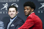 FILE - In this Dec. 10, 2016, file photo, Heisman Trophy finalists Baker Mayfield, left, and Lamar Jackson pose for a photo before the Heisman Trophy award ceremony in New York. Cleveland Browns quarterback Baker Mayfield and Baltimore Ravens quarterback Lamar jackson  will meet on Sunday, Sept. 29, 2019, with the stakes supremacy in the AFC North. (AP Photo/Julie Jacobson, File)