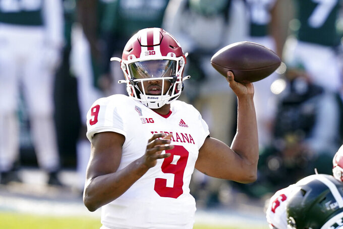 Indiana quarterback Michael Penix Jr. throws during the second half of an NCAA college football game against Michigan State, Saturday, Nov. 14, 2020, in East Lansing, Mich. (AP Photo/Carlos Osorio)