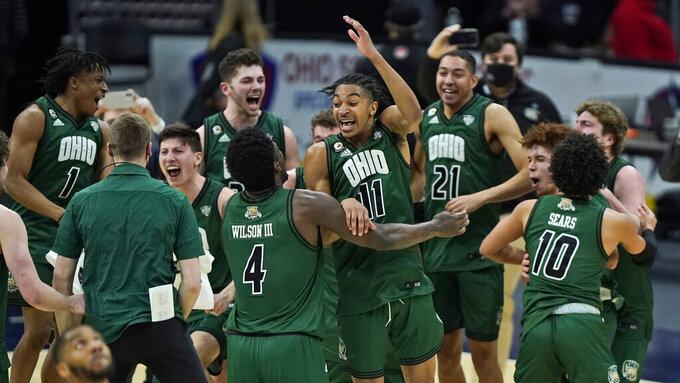 Ohio celebrates after defeating Buffalo in an NCAA college basketball game in the championship of the Mid-American Conference tournament, Saturday, March 13, 2021, in Cleveland. (AP Photo/Tony Dejak)