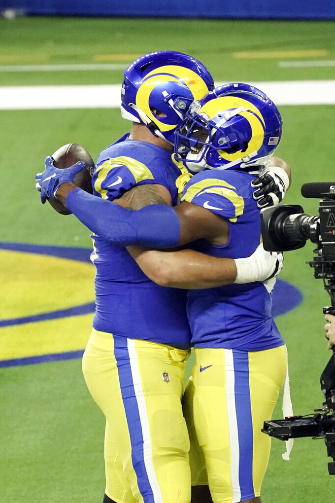 Los Angeles Rams tight end Gerald Everett, right, is hugged by a teammate after a touchdown reception against the Chicago Bears during the second half of an NFL football game Monday, Oct. 26, 2020, in Inglewood, Calif. (AP Photo/Ashley Landis )