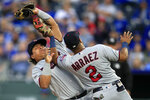 Minnesota Twins first baseman Willians Astudillo, left, is run into by third baseman Luis Arraez (2) while catching a fly ball hit by Kansas City Royals third baseman Hunter Dozier during the seventh inning of a baseball game at Kauffman Stadium in Kansas City, Mo., Saturday, Sept. 28, 2019. Minnesota Twins' Luis Arraez was injured on the play. (AP Photo/Orlin Wagner)