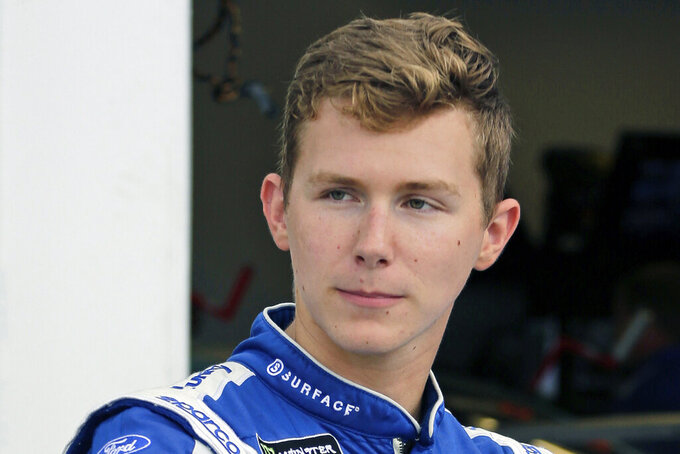 FILE - In this July 4, 2019, file photo, Matt Tifft stands outside his garage during practice at the NASCAR auto race at Daytona International Speedway in Daytona Beach, Fla.  NASCAR will have another new team in 2021 — bringing the total to three new ownership groups in the Cup Series —  with the formation of Live Fast Motorsports. The team formally announced Friday, Nov. 20, 2020, is owned by drivers Matt Tifft and B.J. McLeod. (AP Photo/Terry Renna, File)