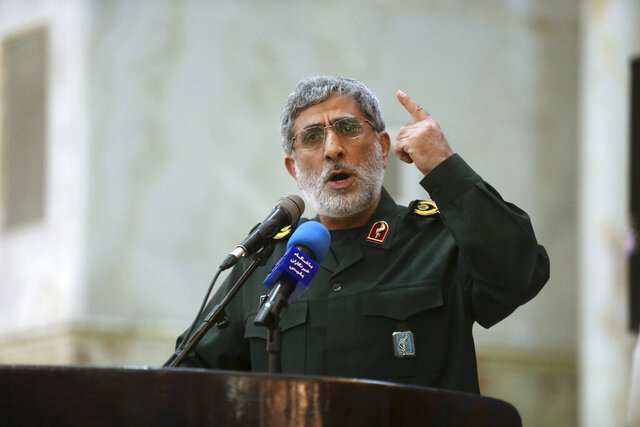 FILE - In this May 24, 2017 file photo, Gen. Esmail Ghaani speaks in a meeting at the shrine of the late revolutionary founder Ayatollah Khomeini just outside Tehran, Iran. Iraqi officials said Ghaani arrived in Baghdad this week to try and unify Iraq's fractured political leaders as stiff opposition by one major bloc thwarts the chances the country's latest prime minister-designate can form a government. Ghaani, head of Iran's expeditionary Quds Force, arrived in Iraq on his first public visit to the country since succeeding slain Iranian general Qassim Soleimani. (Hossein Zohrevand/Tasnim News Agency via AP, File)