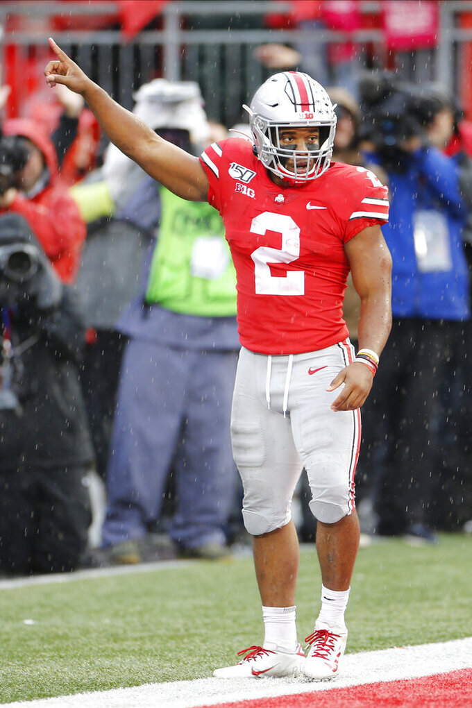 Ohio State running back J.K. Dobbins celebrates his touchdown against Wisconsin during the second half of an NCAA college football game Saturday, Oct. 26, 2019, in Columbus, Ohio. Ohio State beat Wisconsin 38-7. (AP Photo/Jay LaPrete)
