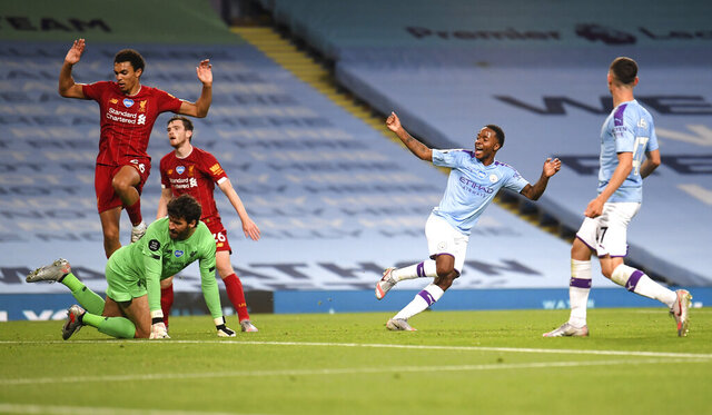 Manchester City's Raheem Sterling, second right, celebrates after his team's fourth goal during the English Premier League soccer match between Manchester City and Liverpool at Etihad Stadium in Manchester, England, Thursday, July 2, 2020. (AP Photo/Laurence Griffiths,Pool)