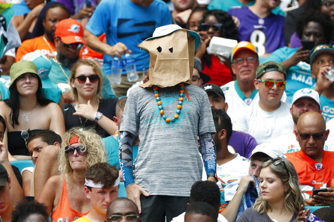 A Miami Dolphins fan shows his displeasure with the team, during the first half at an NFL football game against the Baltimore Ravens, Sunday, Sept. 8, 2019, in Miami Gardens, Fla. (AP Photo/Wilfredo Lee)