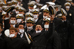 Navy Midshipmen cheer during the first half of an NCAA college football game against Army on Saturday, Dec. 12, 2020, in West Point, N.Y. (AP Photo/Adam Hunger)