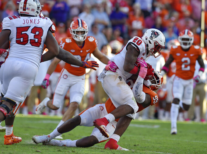 Clemson's Clelin Ferrell tackles North Carolina State's Ricky Person Jr. during the second half of an NCAA college football game Saturday, Oct. 20, 2018, in Clemson, S.C. (AP Photo/Richard Shiro)