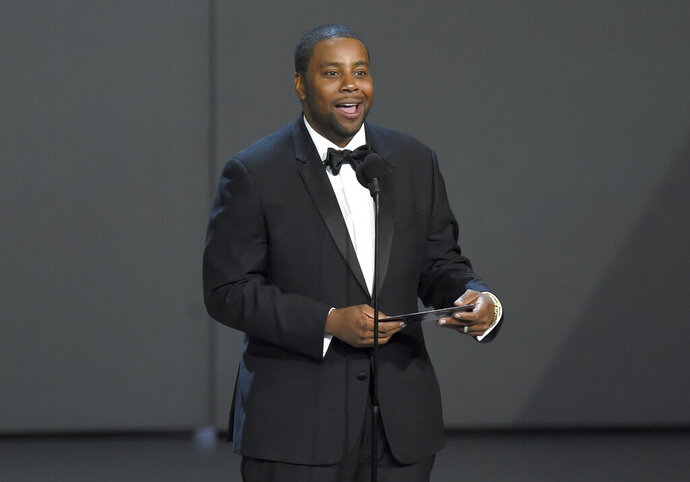 "FILE - In this Sept. 17, 2018, file photo Kenan Thompson presents the award for outstanding drama series at the 70th Primetime Emmy Awards at the Microsoft Theater in Los Angeles. Thompson of ""Saturday Night Live"" and Hasan Minhaj of Netflix's ""Patriot Act with Hasan Minhaj"" will headline this year's White House Correspondents' Dinner which takes place April 25, 2020. (Photo by Chris Pizzello/Invision/AP, File)"