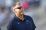 Then-Penn State offensive coordinator Ricky Rahne watches his players warm up for an NCAA college football game against Buffalo in State College, Pa., on Sept. 7, 2019. Rahne is coaching his first game with Old Dominion despite being hired in December 2019. The school canceled all fall sports last year amid the COVID-19 pandemic. (AP Photo/Barry Reeger)