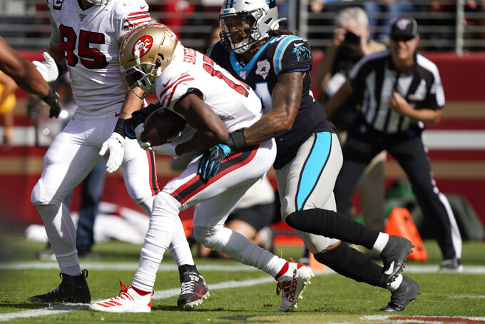 San Francisco 49ers wide receiver Emmanuel Sanders scores a touchdown as Carolina Panthers outside linebacker Shaq Thompson looks on during the first half of an NFL football game in Santa Clara, Calif., Sunday, Oct. 27, 2019. (AP Photo/Tony Avelar)