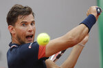 FILE - In this June 10, 2018, file photo, Austria's Dominic Thiem plays a shot against Spain's Rafael Nadal in the men's final match of the French Open tennis tournament at the Roland Garros stadium in Paris, France. (AP Photo/Alessandra Tarantino, File)