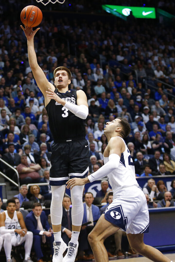 Gonzaga forward Filip Petrusev (3) shoots as BYU forward Gavin Baxter, right, defends during the first half of an NCAA college basketball game Saturday, Feb. 22, 2020, in Provo, Utah. (AP Photo/Rick Bowmer)