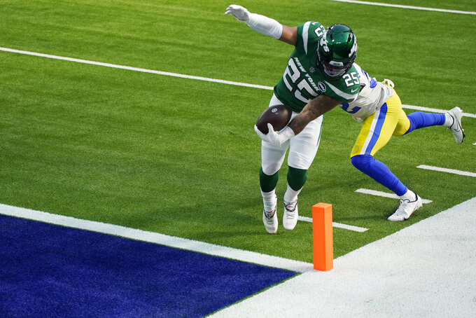 New York Jets running back Ty Johnson (25) scores a touchdown against the Los Angeles Rams during the first half of an NFL football game Sunday, Dec. 20, 2020, in Inglewood, Calif. (AP Photo/Ashley Landis)