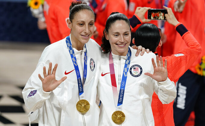 United States's Sue Bird, right, and Diana Taurasi pose with their gold medals during the medal ceremony for women's basketball at the 2020 Summer Olympics, Sunday, Aug. 8, 2021, in Saitama, Japan. (AP Photo/Charlie Neibergall)