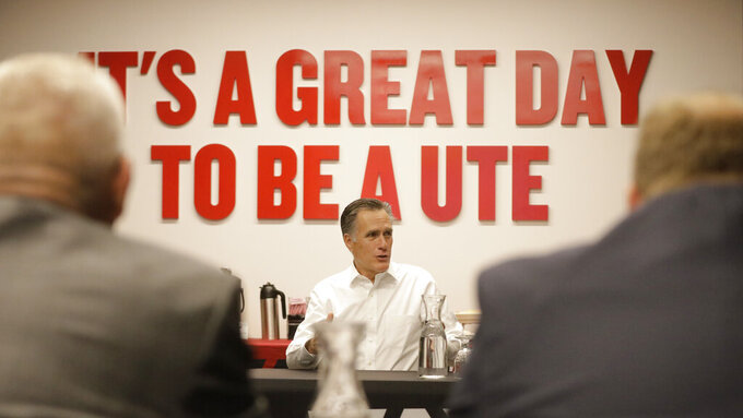 Utah Sen. Mitt Romney speaks with athletic directors from Utah colleges during a meeting at the University of Utah Friday, Nov. 15, 2019, in Salt Lake City. Romney says he supports efforts to allow college athletes to profit from their name and image because he wants to help poor students who may never become professional athletes. (AP Photo/Rick Bowmer)