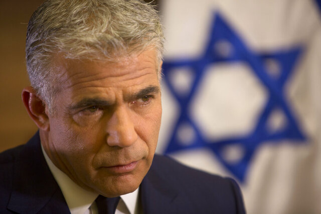 "FILE - In this Oct. 31, 2016 file photo, Israeli Knesset member, Yair Lapid, gives an interview in his office at the Knesset, Israel's parliament, in Jerusalem. Lapid, the co-leader of Israel's opposition Blue and White party said Monday, Feb. 10, 2020, that President Donald Trump's Mideast plan offers a promising blueprint for resolving the Israeli-Palestinian conflict, but that Prime Minister Benjamin Netanyahu had turned it into a campaign ""stunt"" by pushing for immediate annexation of West Bank settlements. (AP Photo/Sebastian Scheiner, File)"