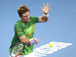 Kevin Anderson of South Africa plays a shot during his match against Novak Djokovic of Serbia at the ATP Cup tennis tournament in Brisbane, Australia, Saturday, Jan. 4, 2020. (AP Photo/Tertius Pickard)