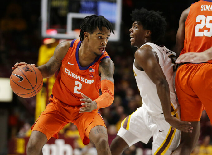 Clemson guard Al-Amir Dawes (2) drives against Minnesota guard Marcus Carr (5) in the second half during an NCAA college basketball game Monday, Dec. 2, 2019, in Minneapolis. (AP Photo/Andy Clayton-King)