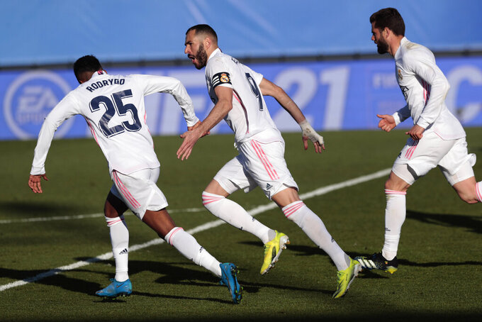 Real Madrid's Karim Benzema celebrates scoring his side's first goal during the Spanish La Liga soccer match between Real Madrid and Elche at the Alfredo di Stefano stadium in Madrid, Spain, Saturday, March 13, 2021. (AP Photo/Bernat Armangue)